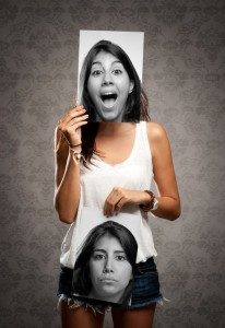 Women with two pictures of her self, one expressing happiness and the other sad, depresssed and anxious.