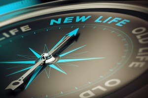 Compass pointing to words New Life